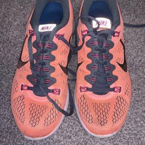 Pink Nike Lunarlon Tennis Shoes